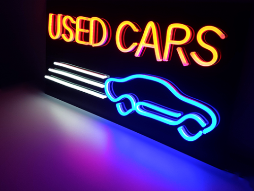 used-cars-neon-sign.png
